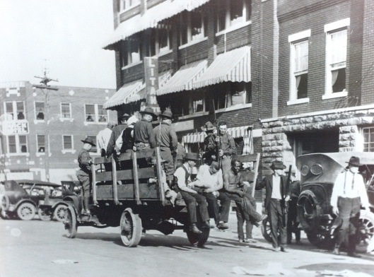 Caption: Blacks being taken to the Brady Theater during the 1921 Tulsa Race Riot near Greenwood. (photo courtesy Greenwood Cultural Center) Photographer: Kelly Kerr Title: staff photographer Credit: Tulsa World City: Tulsa State: OK Country: USA Date: 19970620 CaptionWriter: KK Category: NEW Source: Tulsa World.